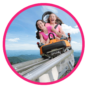 girls riding alpine coaster