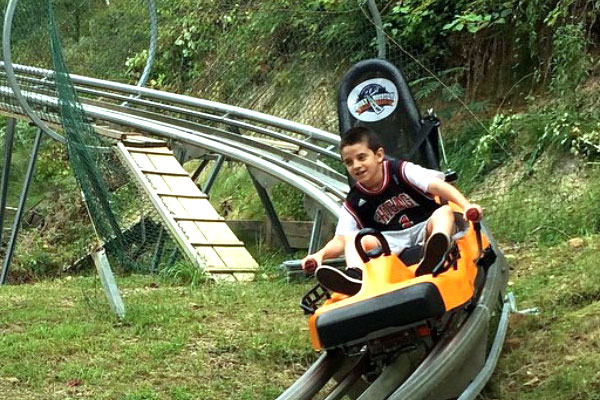 child riding alpine coaster pigeon forge tennesee